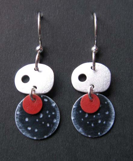 Oval silver with black and red circle earrings