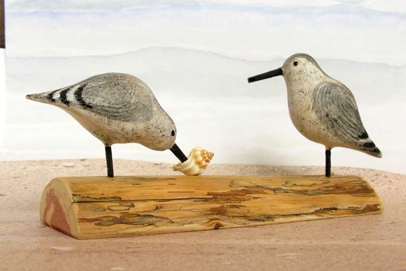 Carved Wood Sandpipers Feeding